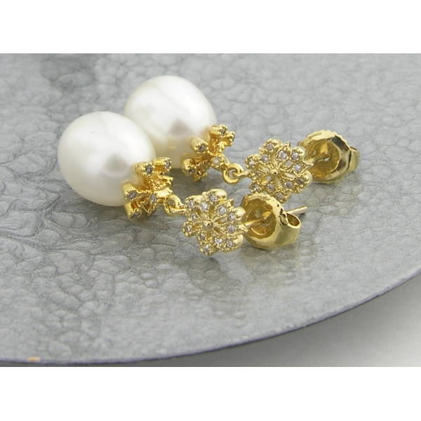 Handmade earrings with freshwater pearls and gold vermeil snowflake earring post