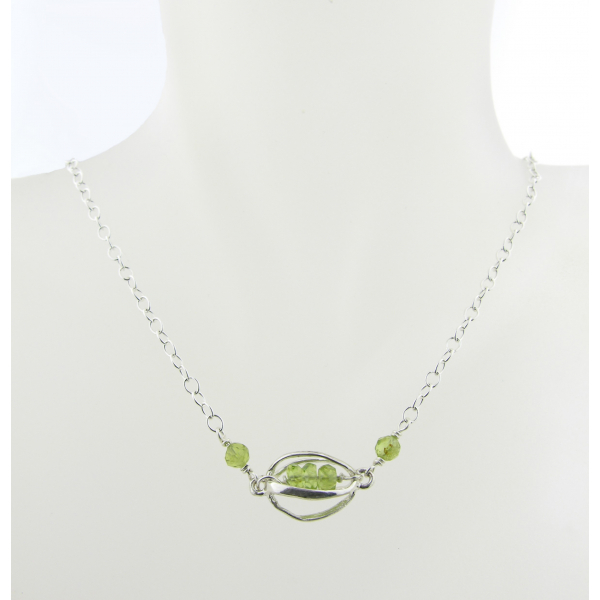 Artisan made sterling silver necklace with peridot gemstones and sterling cage