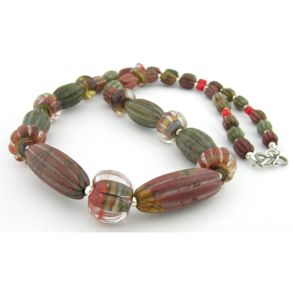 Handmade necklace with carved red creek jasper lampwork coral sterling