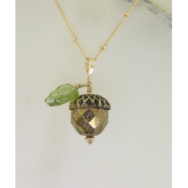 Handmade necklace with faceted golden glass acorn green glass leaf gold fill