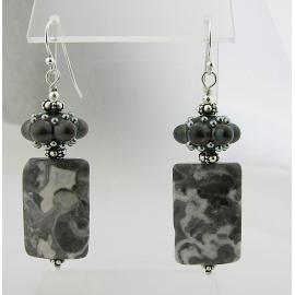 Handmade grey and white earrings with Alaska granite, black dot artisan lampwork