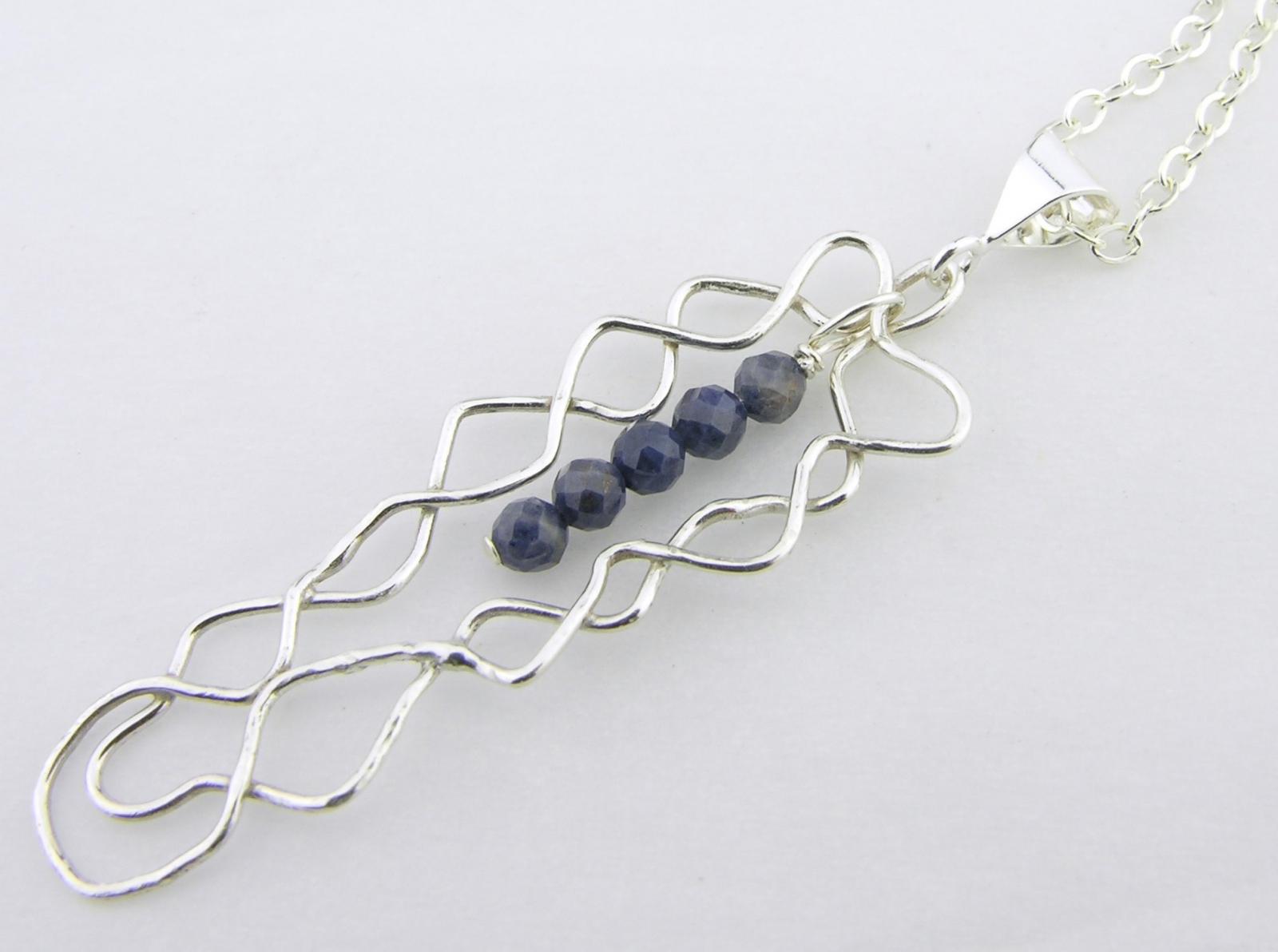 mish mesh and the blues necklace twisted halos blue sapphire
